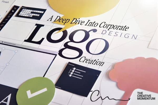 A Deep Dive Into Corporate Logo Design. Desk covered in tools and icons: green check, yellow word bubble, gridlined paper.