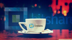 The bitshares logo is pictured printed on a coffee cup against a backdrop featuring the same logo