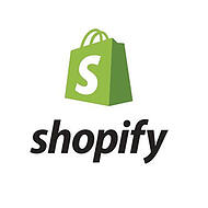 """Shopify is a great CMS choice if you need eCommerce capabilities. Shopify logo - green bag with """"S,"""" """"Shopify"""" in black."""