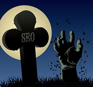 """You may need to adjust your SEO strategy. A full moon, """"SEO"""" on a grave and a zombie hand stretching out of the ground."""