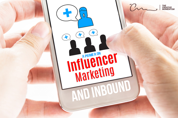 A Primer on Influencer Marketing and Inbound written on a smartphone that is being held close-up.