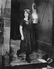 Hopefully your site navigation doesn't require a torch and map. [vintage photo] Lady, looking lost, holds up a large lantern.