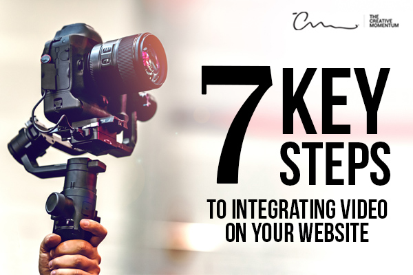 Follow these 7 key steps to integrate video on your website. Hand holds up a video camera.