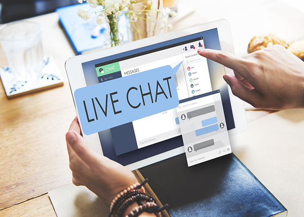 Engaging visitors with live chat can boost your ecommerce sales - Laptop screen with live chat