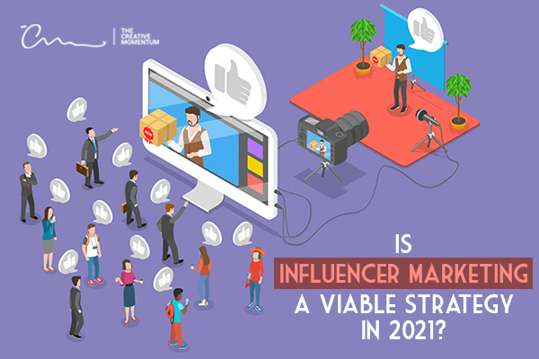 Is influencer marketing a viable strategy in 2020? - Influencer in front of a camera speaking to a crowd