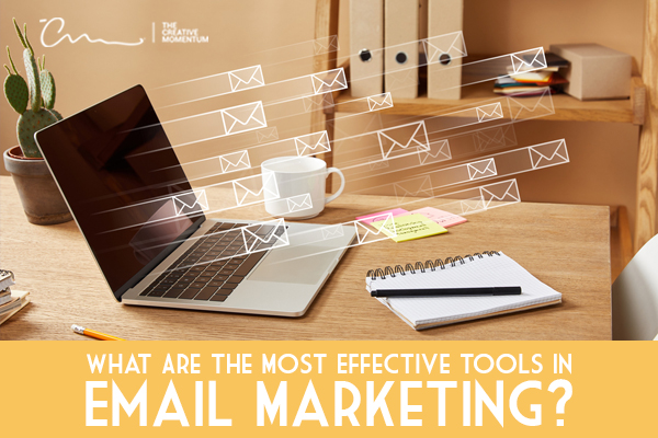 Here's a list of the most effective email marketing tools - laptop on desk with flying envelopes